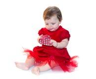 baby meisje in rood Stock Afbeeldingen