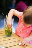 Baby messing up the lemonade Stock Photo