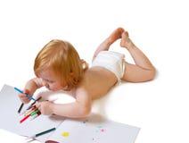 Baby met album en zacht-uiteindepen Royalty-vrije Stock Foto's