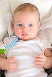 Baby met blauwe ogen Stock Foto