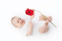Baby met bloem stock afbeelding