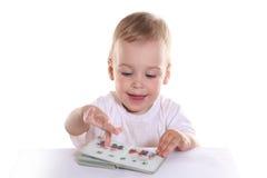 Baby met boek Stock Fotografie
