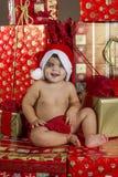 Baby met de giften van Kerstmis Royalty-vrije Stock Fotografie