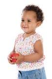 Baby met een appel Stock Foto