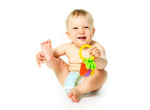 Baby met een stuk speelgoed Royalty-vrije Stock Foto's