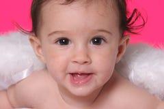 Baby met engelenvleugels stock afbeeldingen