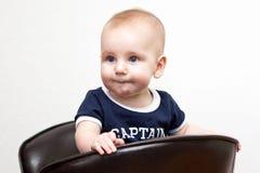 Baby met grappige uitdrukking stock afbeeldingen