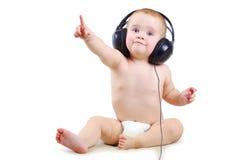 Baby met hoofdtelefoon Stock Fotografie