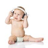 Baby met hoofdtelefoon. stock foto's