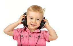 Baby met hoofdtelefoons Royalty-vrije Stock Afbeeldingen