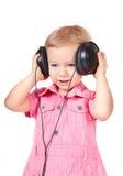 Baby met hoofdtelefoons Stock Foto's