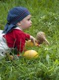 Baby met muzikale instrumenten Stock Fotografie