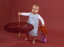 Baby met parasol Royalty-vrije Stock Afbeeldingen