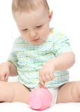 Baby met spaarvarken stock afbeelding