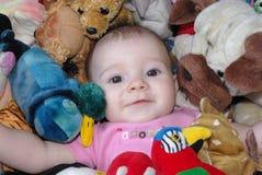 Baby met speelgoed Stock Foto's