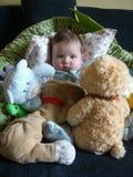Baby met speelgoed stock afbeeldingen
