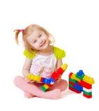 Baby met speelgoed die op wit wordt geïsoleerdo Royalty-vrije Stock Foto