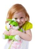 Baby met speelgoed die op wit wordt geïsoleerdv Stock Fotografie