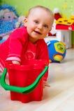 Baby met stuk speelgoed Royalty-vrije Stock Foto's