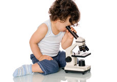 Baby with microscope. Baby with microscope, isolated on a white background Royalty Free Stock Images