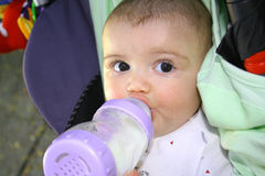 Baby with milk. Royalty Free Stock Photos