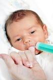 Baby with milk Stock Image