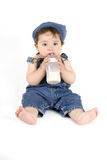 Baby with a milk bottle Royalty Free Stock Photos