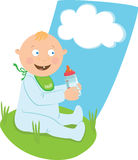 Baby with a milk bottle. On the grass Stock Image