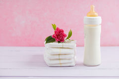 Baby milk bottle and diapers Royalty Free Stock Photography