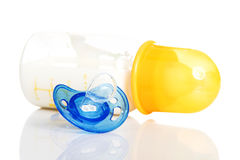 Baby milk bottle and dummy Stock Images