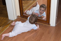 Baby with mirror stock image