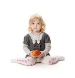 Baby mit Apfel Stockbild