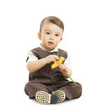Baby mit Blume, gut gekleidetes Kind in der Klage Kinderretrostil, ein jähriges Kind Stockfotografie