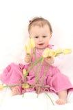 Baby mit Blumen Lizenzfreie Stockfotografie