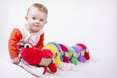 Baby mit dem Hundertfüßer Lizenzfreie Stockfotografie