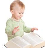 Baby mit einem Buch Stockbild