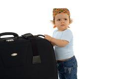 Baby mit sehr großem Gepäck Stockfoto