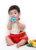 Baby mit Spielwaren Lizenzfreie Stockfotos