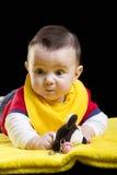 Baby mit Spielzeug Stockbild