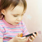 Baby with mobil telephone Royalty Free Stock Photo