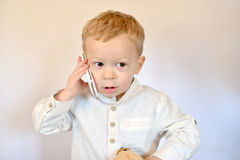 Baby with a mobile phone Stock Photography