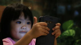 Baby with mobile phone stock video