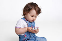 Baby with mobile phone Stock Images