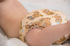 baby in modern eco stacks of cloth diapers  Stock Photo