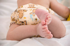 baby in modern eco stacks of cloth diapers Royalty Free Stock Image
