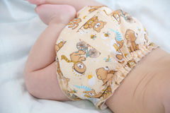 baby in modern eco stacks of cloth diapers and replacement bushings Stock Images