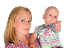 Baby with mom Stock Images