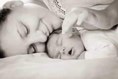 Baby with mom. Sleep baby with mom, closeup faces royalty free stock photo