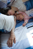 Baby with mom. In the bed Stock Photography