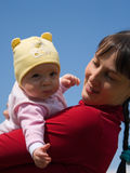 Baby with mom. On blue sky background Royalty Free Stock Image